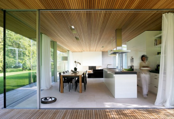 Glass Bungalow Design with Some Wooden Materials Kitchen and Dining Table