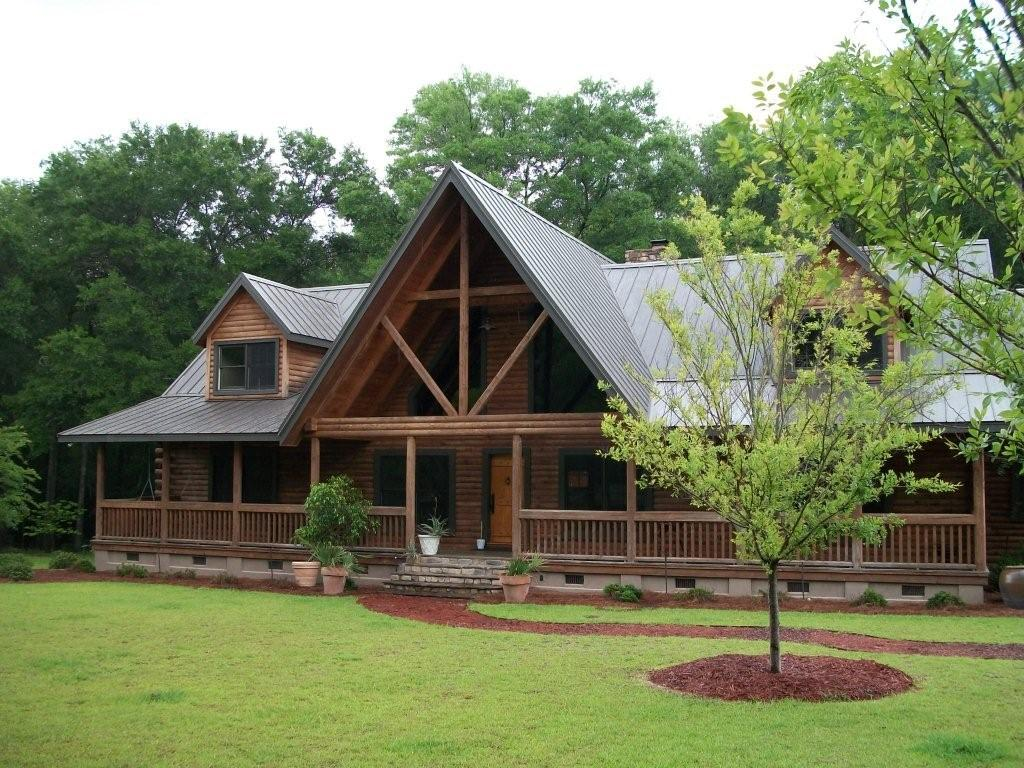 Log cabin homes architecture world for Lodge home designs