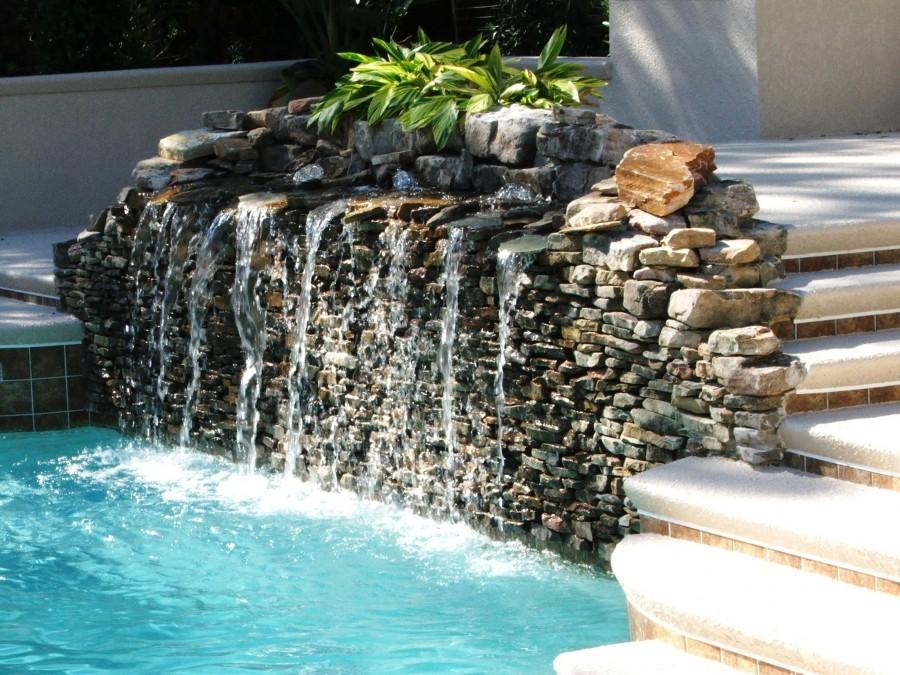 Wonderful Waterfall Design in the Rear Garden Swimming Pool