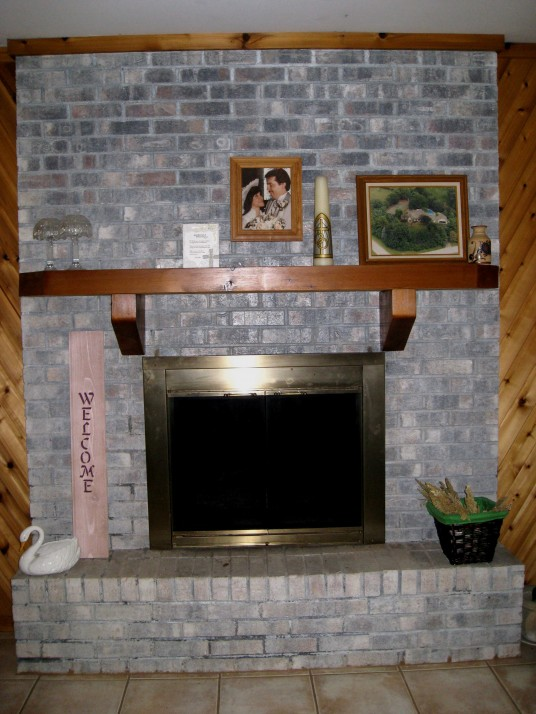 Fireplace-Before-Makeover-with-Brick-and-Metal
